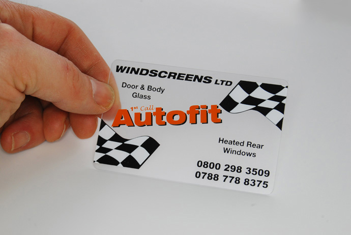 a frosted plastic card printed with black, white and orange ink
