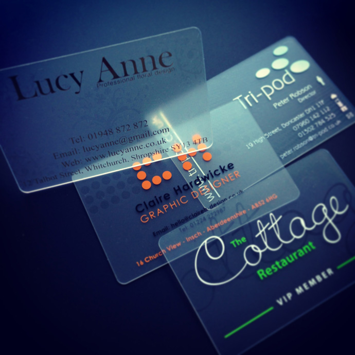 a frosted plastic card printed with clear ink to create a watermark effect