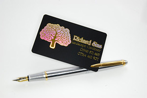 black plastic card with holographic printing