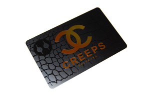 a satin black plastic business card with metallic gold foiling